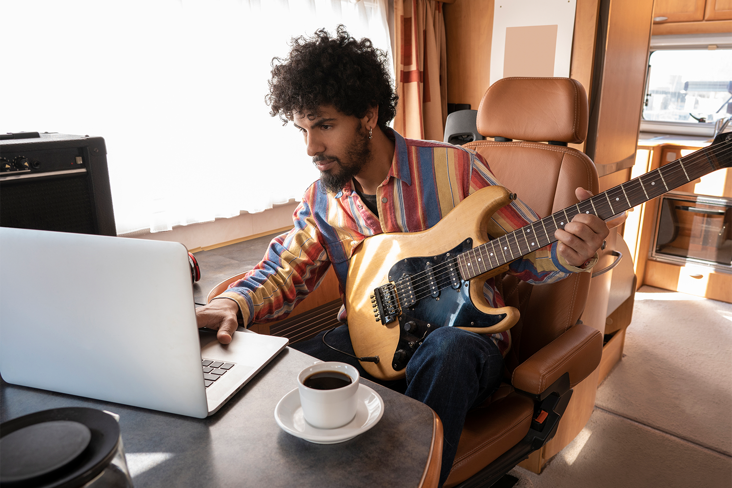 5 Tips For Staying Active In Your Songwriting Practice While Touring